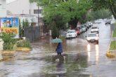 Bueiro entupido na Av. Venâncio Aires esquina com a 25 de Julho (sentido sul/norte)
